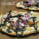 Goat cheese and pear pizza with balsamic reduction