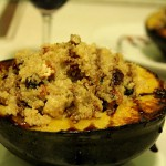 quinoa stuffed acorn squash with pecans and raisins