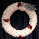a pom pom christmas wreath